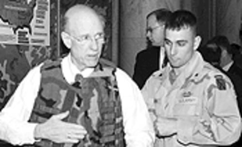 Republican Sen. Pat Roberts of Kansas models Point Blank's body armor.