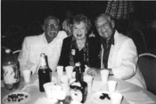 Hyman Kantofsky (right) sits at dinner with his sister, Evelyn Messing, and their friend, George Horn, about a year before jumping to his death