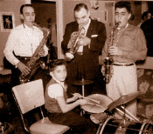The family that plays together: Dominick Turso (left) jams with sons Mauro (right, on sax) and Ron (on drums), while Tony Reynolds plays trumpet