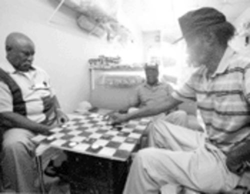 An endless checkers tournament fills another slow business day at Howard�s Candy Store on NW 31st Avenue