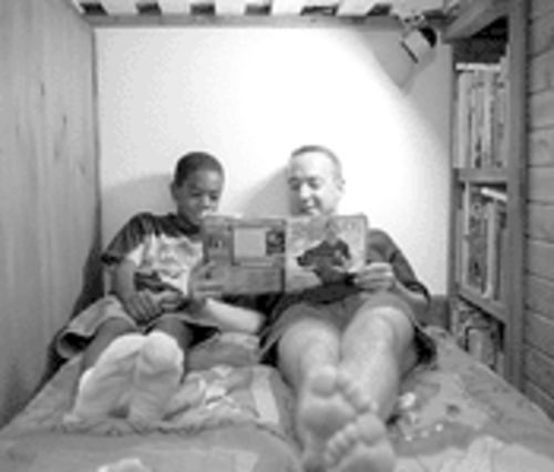 Reading is part of the daily ritual for foster father and son