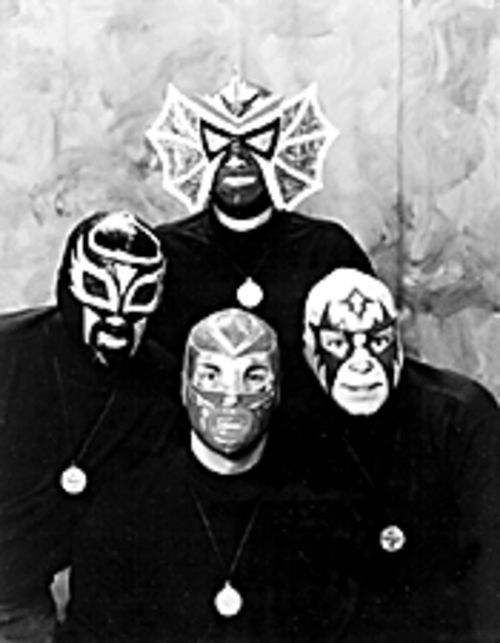 Los Straitjackets get serious at Sears portrait studio.