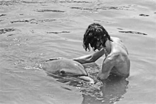 Malcolm Brenner, photographed in the early 1970s with the dolphin he says was the love of his life.