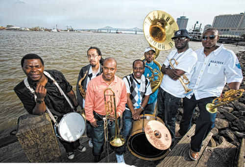 The Rebirth Brass Band, rises above.