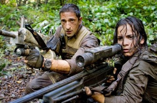 Adrien Brody and Alice Braga may be the ultimate prey, but someone gave them big guns.