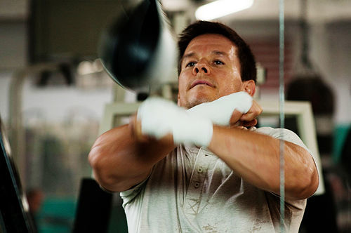 Mark Wahlberg shows off years of training.