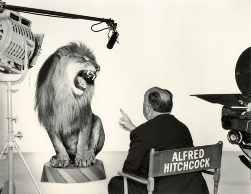 Alfred Hitchcock with the MGM Lion in 1958.