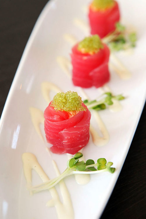 Tamari scallops: Rich, premium, soy-moistened scallops and crabmeat wrapped in tuna.