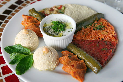 The absurdly generous cold appetizer platter ($16) includes tabbouleh, smoked eggplant salad, baba gannouj, and ezme.