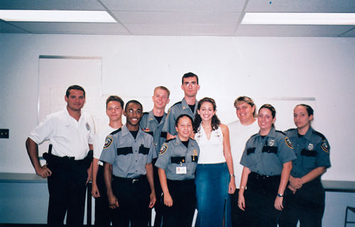John Wolfe (center) with other members of his Police Explorer unit.