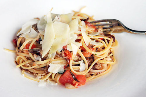 Spaghetti with fresh tomato, pepper salsa, and shaved Parmesan.