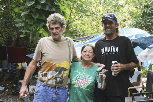 Mark, a Democrat, and friends live in the woods outside of a DeLand, Fla., flea market.