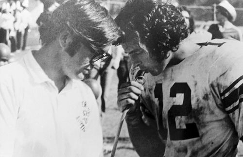 Crist (right) played quarterback for the St. Pete High Green Devils.