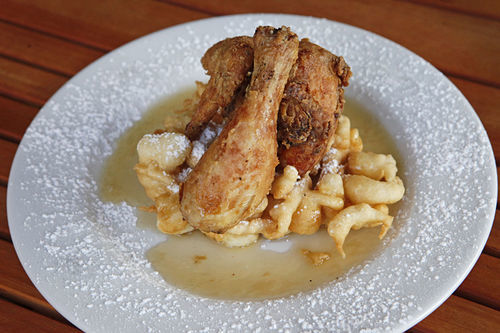 Carnival Chicken: a buttermilk-marinated, half-fried bird, funnel cake, and powdered sugar.