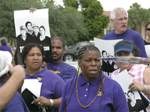 Displaced Nova workers protest outside the school with the SEIU.