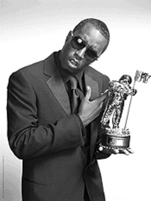 Oops, he Diddy�d again: Sean Combs hosts the MTV awards.