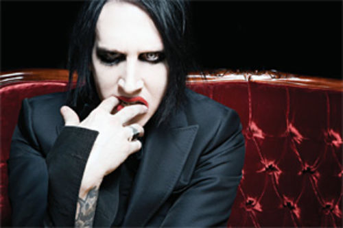 Manson is the darkest white guy in a room.