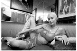 Leslie Glass lounges in a private back room at Pure Platinum, where she has danced for Richard Gere and Chris Rock