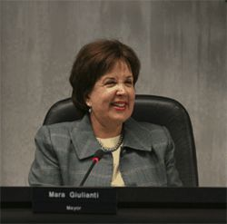 Mayor Mara Giulianti leads a city government that has given tens of millions of dollars to affluent developers.