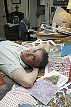 Tab hunter: Thomas Lyttle reclines with his blotter collection and books.