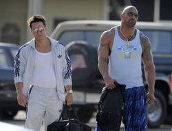 Mark Wahlberg and Dwayne Johnson on the set of Pain & Gain.