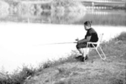 A young girl fishes a canal in western Broward County where larger fish carry mercury in quantities that put women and children at the greatest risk