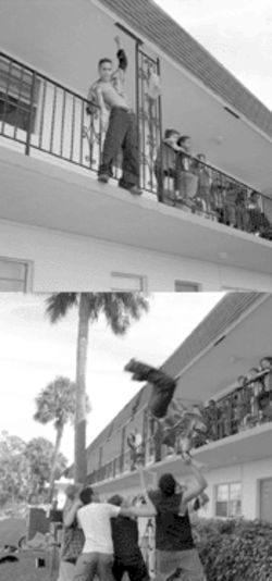 At a show last year, John dives from a balcony into the waiting arms of his friends