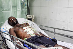 Truck driver Amazan Jean-Uber was shot by bandits. The bullet lodged in his spine, leaving him paralyzed from the waist down.