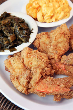 Fried jumbo shrimp, collard greens, and mac &#039;n&#039; cheese.