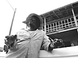 Lamont Oliver escaped the sugar fields, which he says broke many of the imported laborers.