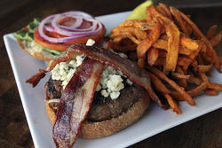 "The ""Bluejay"" burger, with blue cheese, applewood-smoked bacon, and roasted horseradish."