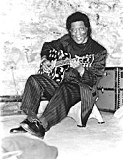 Buddy Guy stole Betty Boop's guitar.