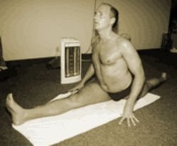 Jimmy Barkan practices in front of a space heater, a required accessory of Bikram yoga