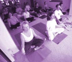 Yogi Hari's students sit cross-legged or in lotus position while focusing on their breathing