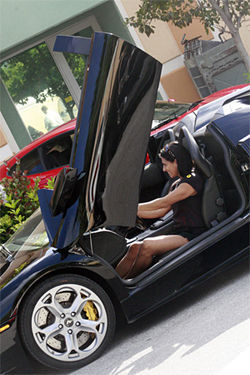 Melisa Conzé tries out a Lamborghini before the Dream Car Tour — a high-speed exotic-car frolic through South Florida.