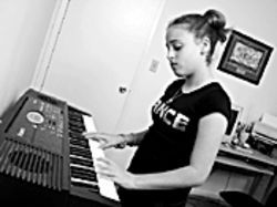 Emmi plays an original trance music composition on her electronic keyboard and computer.