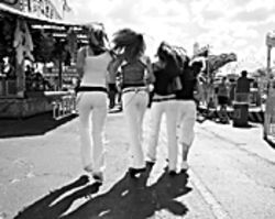 Brittany, Kelsey, Danielle, and Emmi stroll through the Broward County Fair arm in arm.