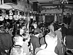 A Saloon crowd swings