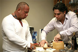 Martorano, with Landi (right), samples imported cured meats and cheeses at Prime Line.
