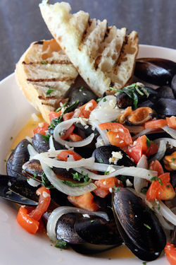 Comforting: Black mussels in white wine, garlic, tomato, and basil with grilled bread.