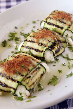 Antipasti of fried zucchini stuffed with mozzarella.