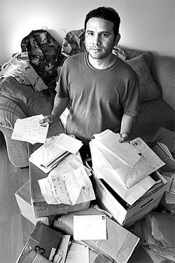 Camilo sits on boxes of correspondence, hundreds of letters he received from supporters while imprisoned at Fort Sill, in Oklahoma.