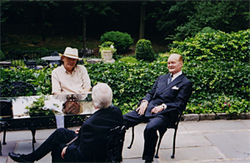 Bruce McMahan and wedding guests sitting at the back patio of his Pelham estate.