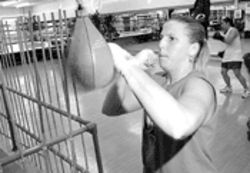 Kara Lucas works the bag at U.S. 1 Fitness