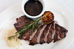 The skirt steak comes sliced and fanned across the plate.