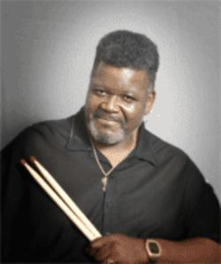 Buddy Miles brings extra-large chopsticks wherever he goes