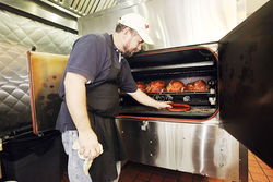 Dave Audet, owner and chef, tends to the meat in his state-of-the-art smoker.