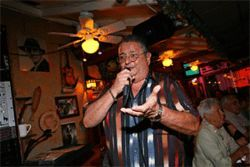 Restaurateur Jorge Sanchez sings karaoke almost as well as he makes flaky empanadas (next picture).