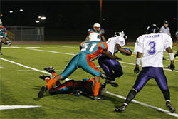 Corrections officer and cornerback Sabrina Baptiste takes down a Diamond receiver.