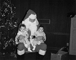 Lauren and Leanna on Santa's lap the day their father disappeared